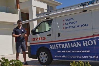 Technician next to Australian Hot Water Service Van