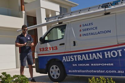 Technician next to Australian Hot Water Service Van
