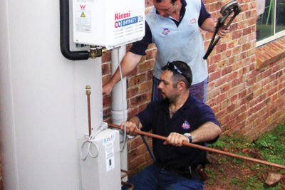 Technicians installing Hot Water Systems