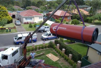 Crane lifting a hot water system